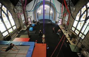 Performers train at the Aloft Loft circus training and teaching school which was converted from a church, in Chicago, Illinois, U.S., September 23, 2016. Picture taken September 23, 2016. REUTERS/Jim Young