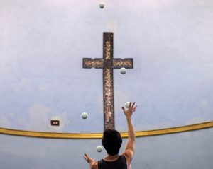 Lucas Aguirre practices his juggling at the Aloft Loft circus training and teaching school which was converted from a church, in Chicago, Illinois, U.S., September 22, 2016. Picture taken September 22, 2016. REUTERS/Jim Young